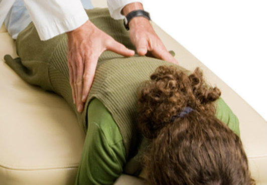 Perception / Reality - Chiropractor adjusting patient